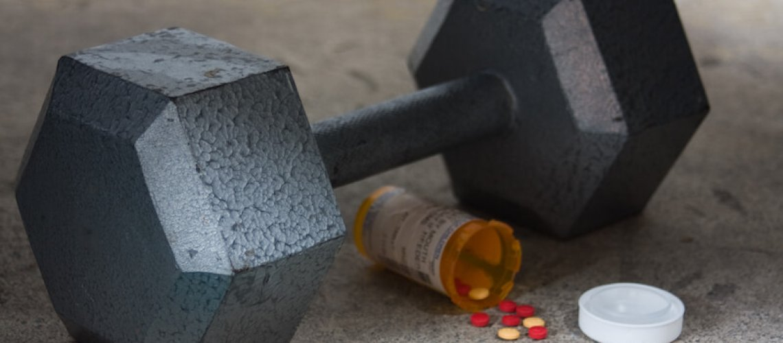 Dumbbell with Performance Enhancing Drugs PEDs